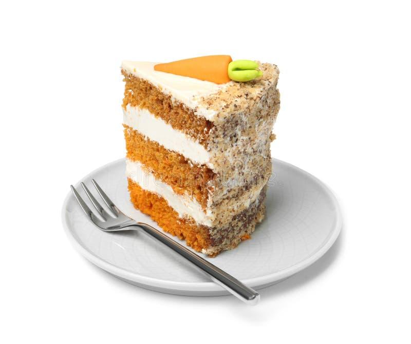 Pedazo de torta de zanahoria dulce con crema deliciosa en la placa foto de archivo libre de regalías