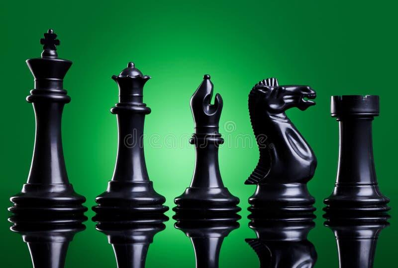 Pedazos de ajedrez negros fotografía de archivo