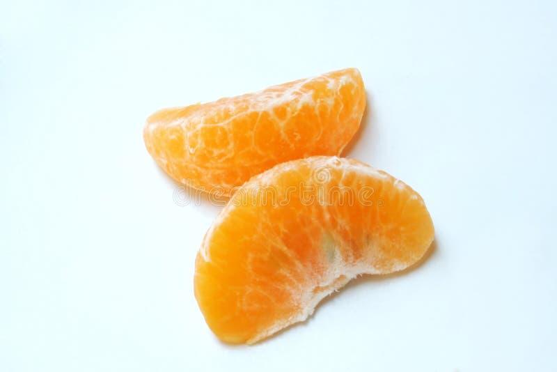 Pedazos de mandarina fotografía de archivo