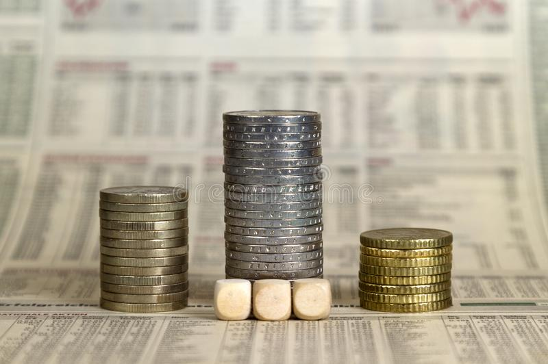 Pedestal from coins on a business newspape stock image
