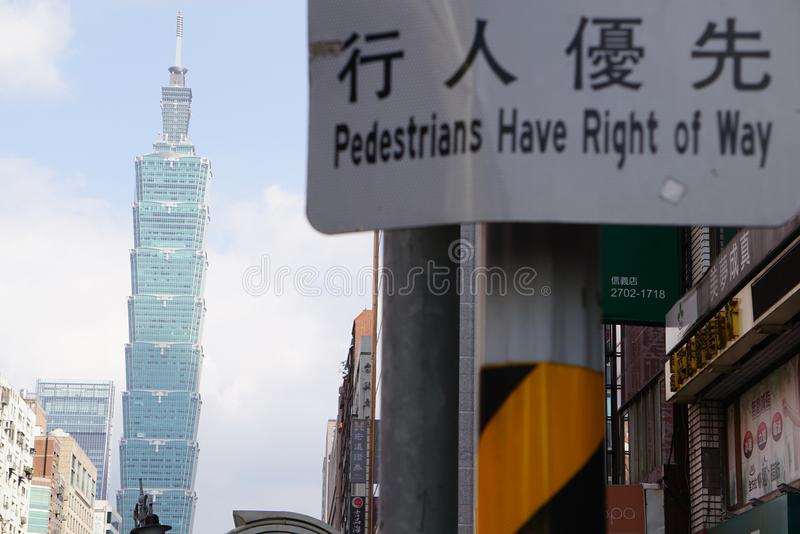 A day walking on the street of Taipei Taiwan in 2018 look at taipei101 building look at Taipei101 passed through street sign. PEDESTRAINS HAVE RIGHT OF WAY sign stock photo