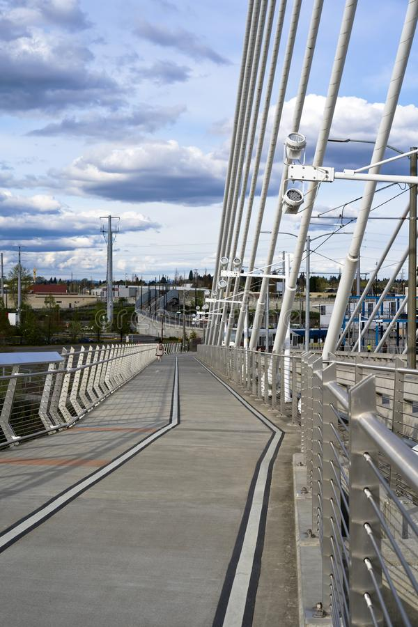 Pedestrian and bicycle path through Tilikum Crossing Bridge across the Willamette River in Portland Oregon. Lined pedestrian and bicycle path next to the stock photography