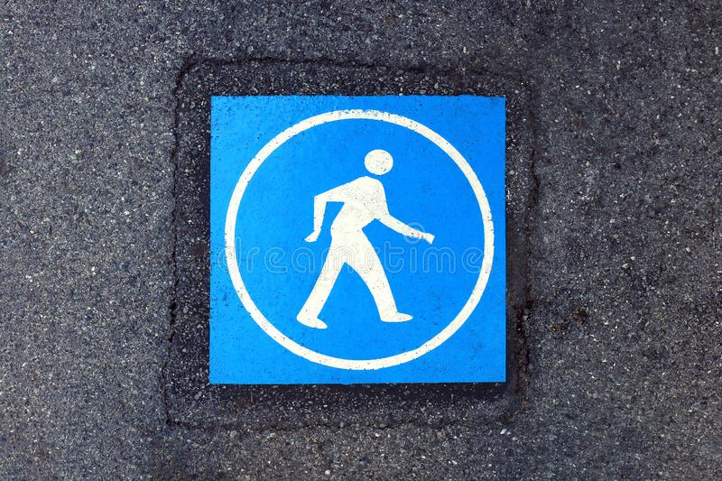 Pedestrian blue warning sign on the road surface, walk sign blue color on footpath, symbol pedestrian walk at sidewalk floor, blue. The pedestrian blue warning royalty free stock image
