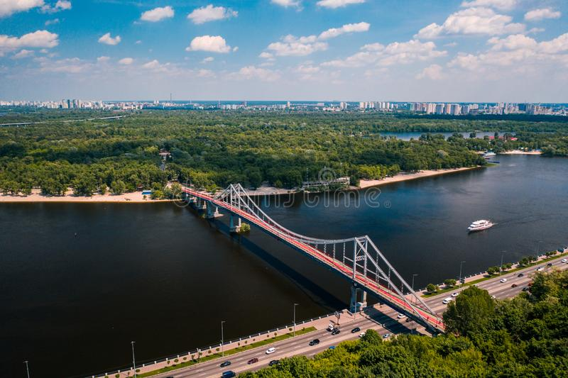 Pedestrian bridge in Kiev across the river. To the park stock photos