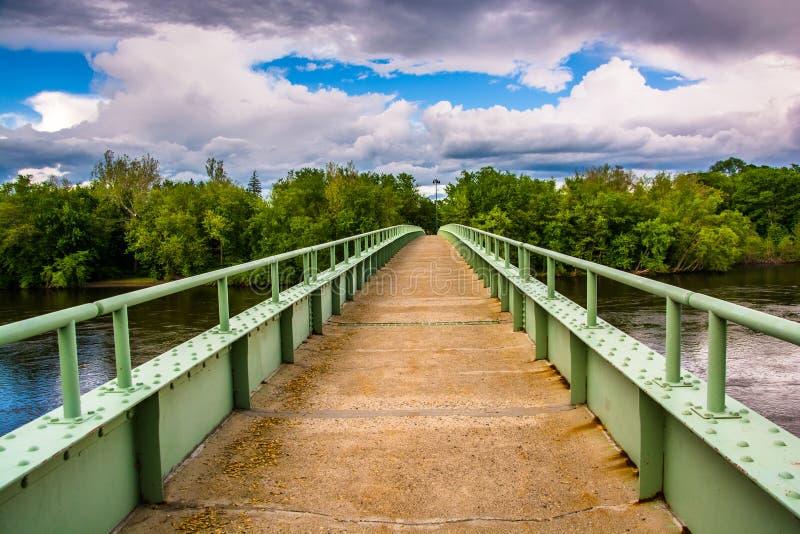 A pedestrian bridge over the Delaware River in Portland, Pennsylvania. stock photo