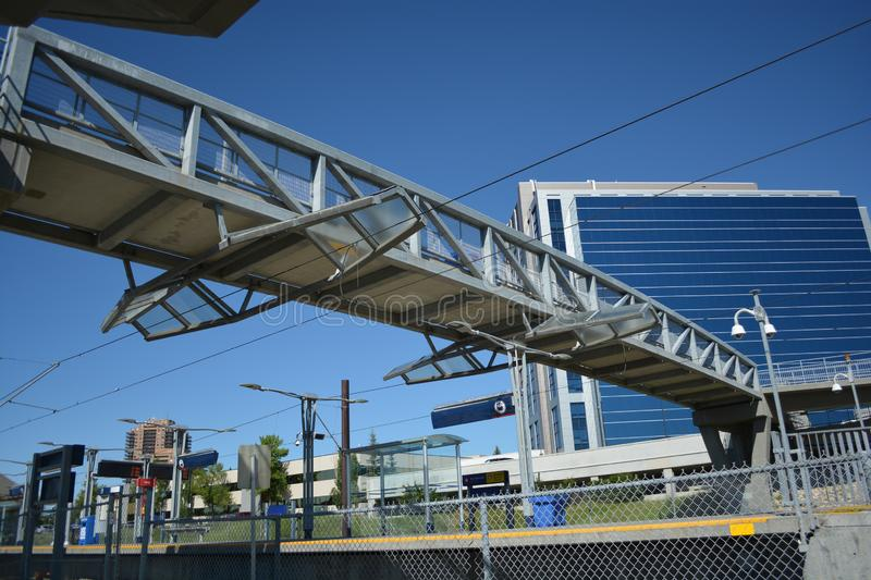 Pedestrian bridge over train track line at city station stock photography