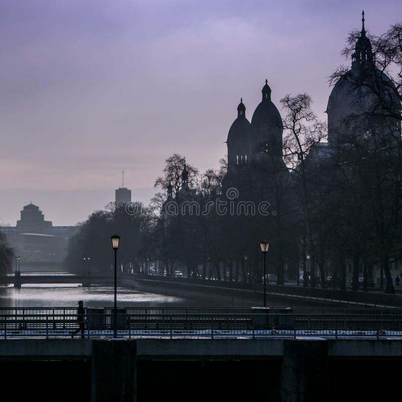 Pedestrian Crossing Bridge In City. Pedestrian Walks On Bridge Over River In City At Dusk royalty free stock images