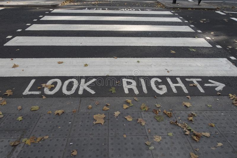 Pedestrian crossing with markings look right on the road. To help tourist to look at the right direction before crossing the road stock photo