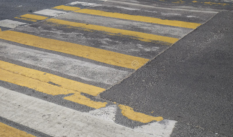 Pedestrian crossing. With the old road markings on a dark asphalt royalty free stock images