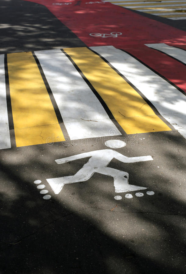 Pedestrian crossing in the Park. With markings for cyclist and skaters royalty free stock photography