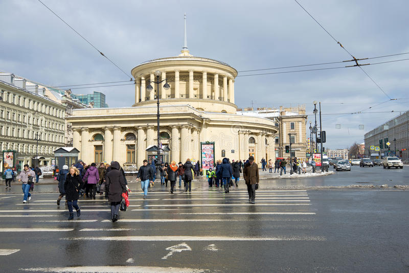 The pedestrian crossing to a lobby of the `Vosstaniya Square` metro station on Nevsky Avenue in the April afternoSaint Petersburg. ST. PETERSBURG, RUSSIA - APRIL stock photo