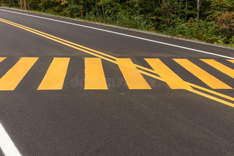 Pedestrian crossing. Yellow stripes on the street stock photos