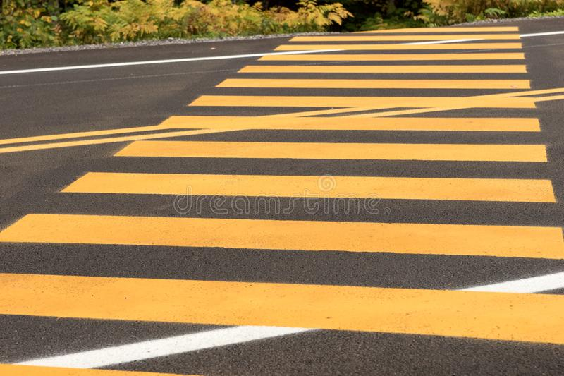 Pedestrian crossing. Yellow stripes on the street stock photography