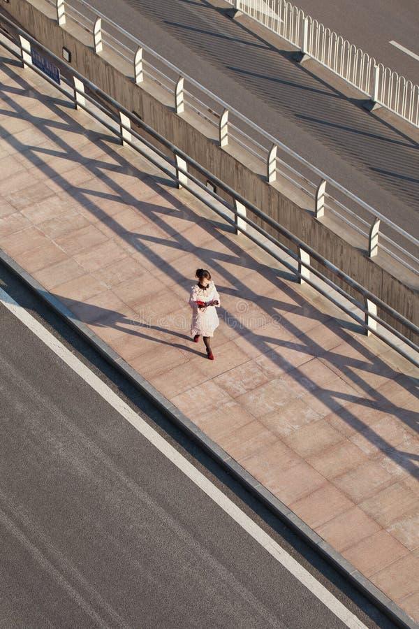 Pedestrian at sidewalk at Beijing Capital International Airport. royalty free stock image