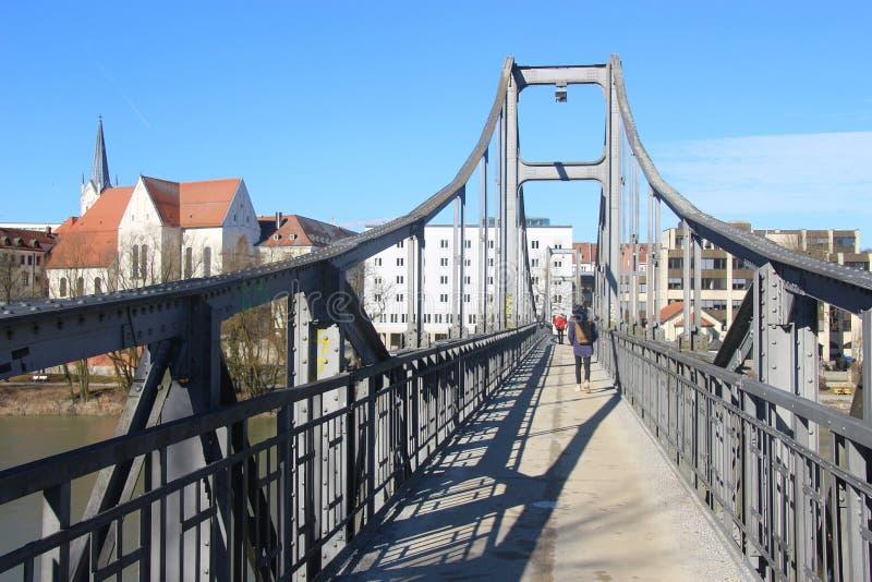 The pedestrian steel bridge Innsteg in Passau, Germany. stock photography