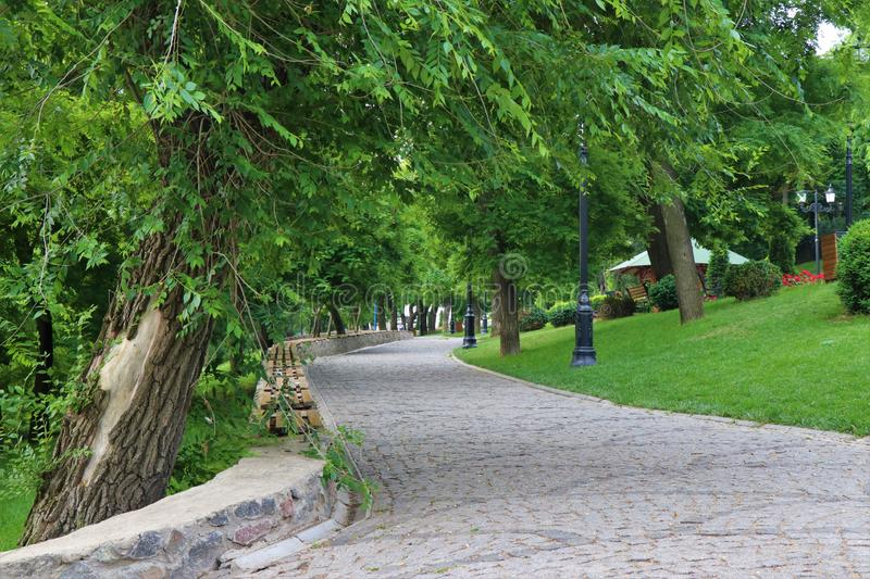 Odessa, Ukraine, Istanbul park. Pedestrian street full of trees. During the day is full of people doing jogging or a walk. Located at the Istanbul park, in stock image