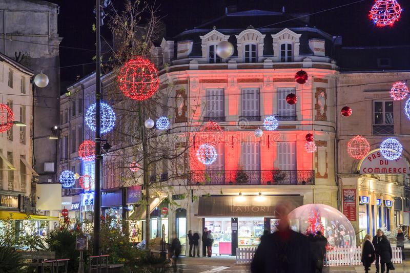 Pedestrian street illuminated by numerous Christmas decoration in the city center of niort royalty free stock images