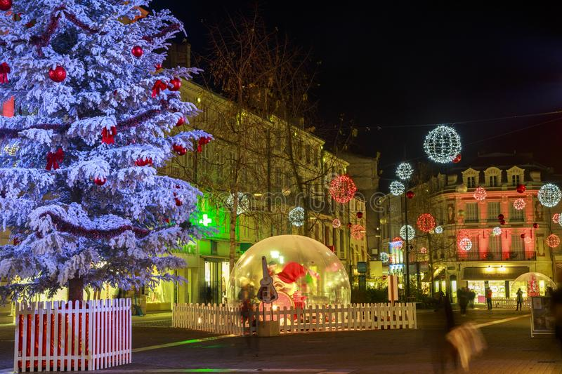 Pedestrian street illuminated by numerous Christmas decoration in the city center of niort stock photography