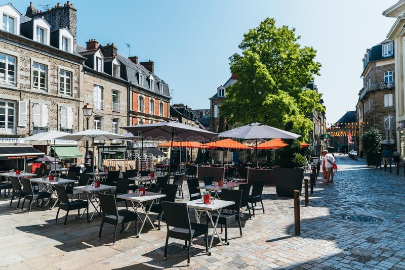Pedestrian street with restaurants in Fougeres, Brittany royalty free stock photography