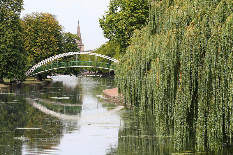 Pedestrian suspension bridge, Bedford, U K. The pedestrian iron suspension bridge over the river Great Ouse in Bedford, United Kingdom. This bridge is a listed stock image