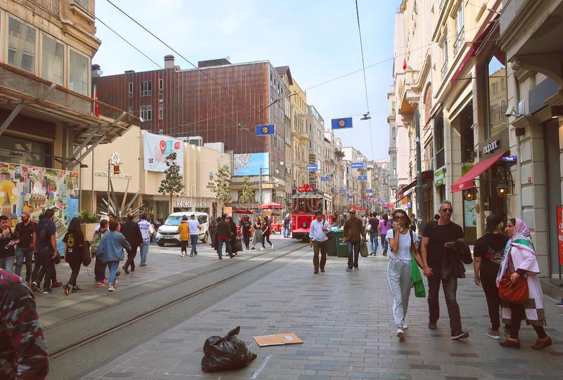 Pedestrian tourist street Istiklal. Istiklal Street is the most popular destination in Beyoglu, Taksim, Ista. Red nostalgic tram stock photography