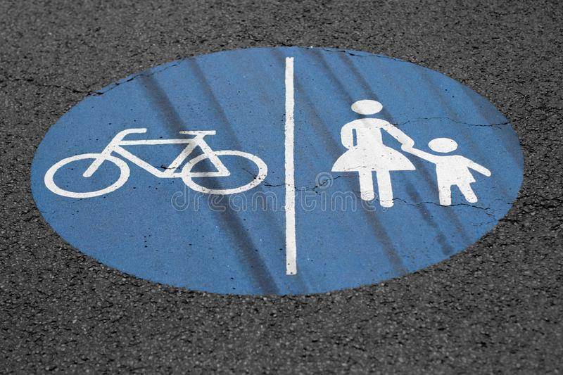 Pedestrians and bicycle way sign on the ground stock photos
