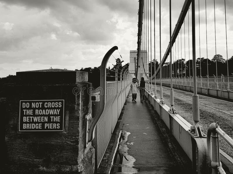 Pedestrians on bridge stock photos