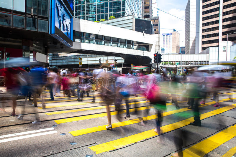 Pedestrians in Central of Hong Kong. Pedestrians crossing road in central of Hong Kong royalty free stock photo