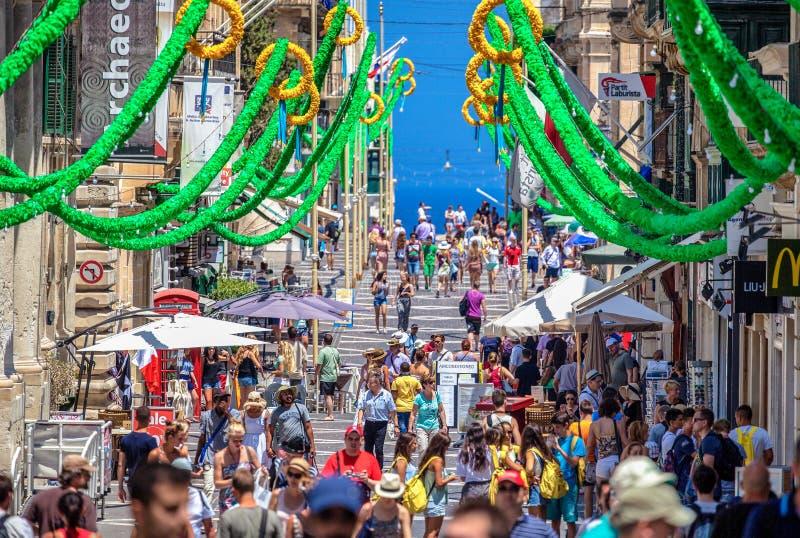 Pedestrians at city Valletta, Malta royalty free stock images