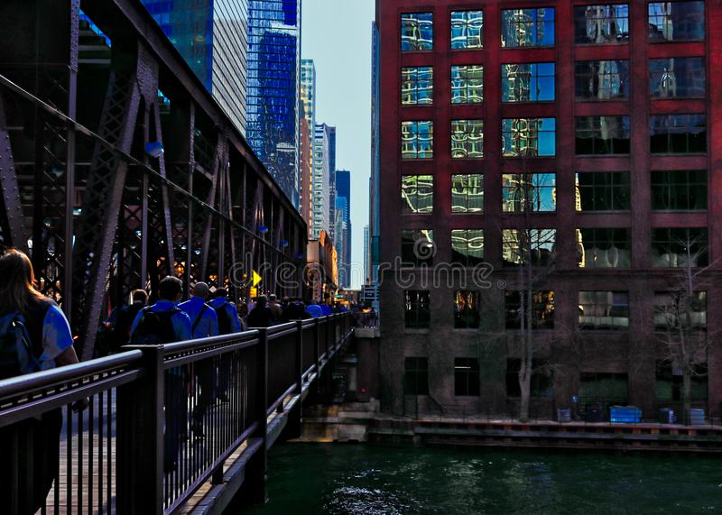 Pedestrians cross the Lake Street bridge over the Chicago River during morning rush hour commute. stock photography