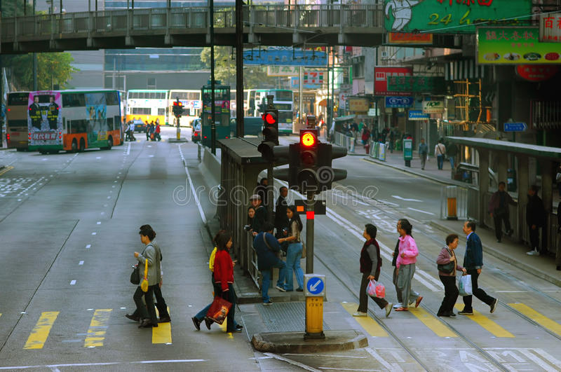 Pedestrians crossing in hong kong. Typical morning scene of pedestrians crossing at north point, hong kong royalty free stock images