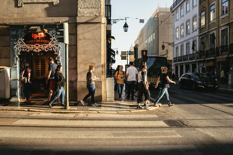 Pedestrians crossing a street at Alfama, Lisbon royalty free stock photos