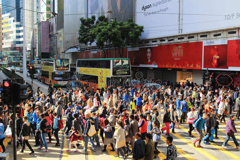 Pedestrians in a crosswalk Causeway Bay district. In Hong Kong royalty free stock photos