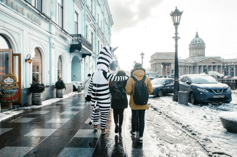 Pedestrians pass Nevsky Prospekt and Griboedova Canal near the Kazan cathedral, St. Petersburg, Russia royalty free stock image