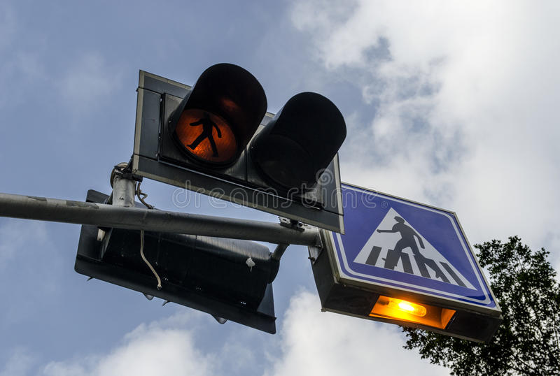 Pedestrians sign and traffic light. Pedestrians sign and blinking yellow traffic light stock image