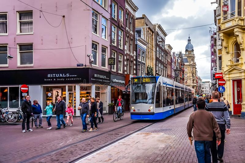 Pedestrians and Trams on the busy Leidsestraat in the center of Amsterdam stock images
