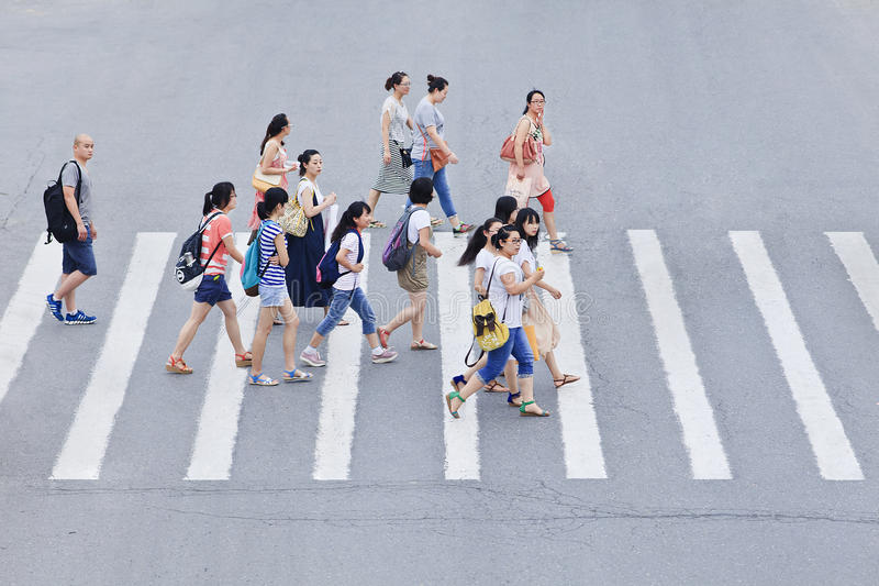 Pedestrians on a zebra crossing, Beijing, China. BEIJING-JULY 18. Pedestrians on zebra path. Side-effect of economic growth in China is high number of traffic royalty free stock image
