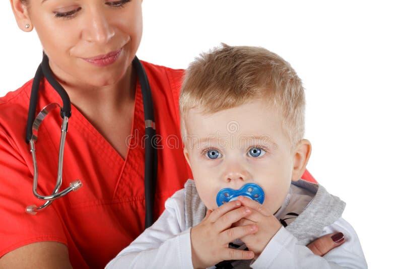 Pediater en kind stock afbeelding
