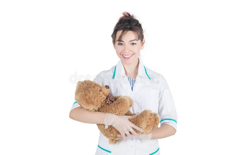 Pediatrician, doctor woman with bear toy, concept stock image