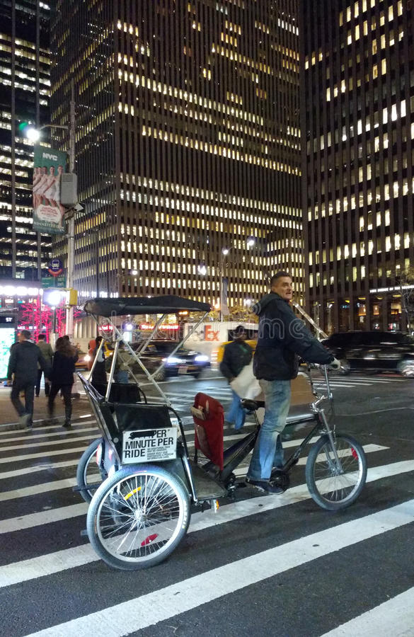 Pedicab in the Crosswalk, Midtown Manhattan, NYC, USA royalty free stock images