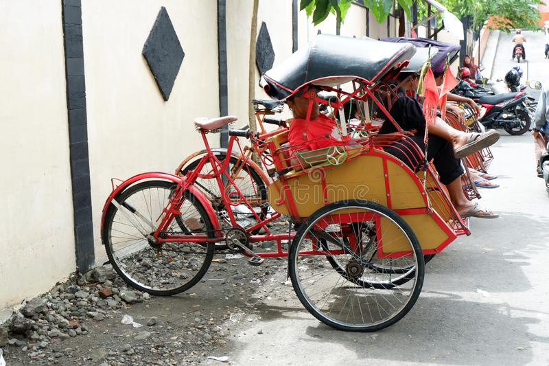 Pedicab on traditional markets. Transportation travel rickshaw street bicycle city asia old vehicle people bike asian taxi tricycle road tourism town traffic stock photo