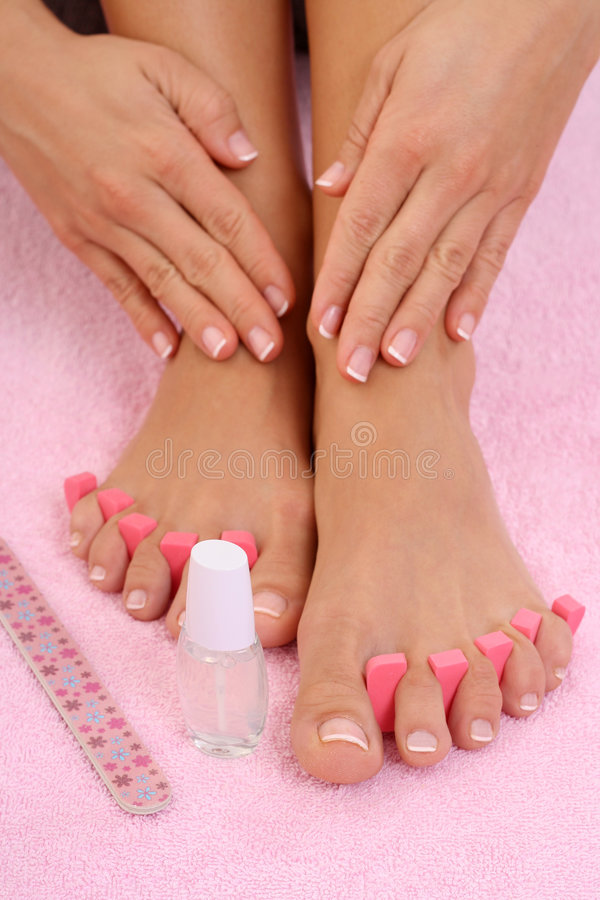 Pedicure. Beautiful female legs with perfect pedicure stock image