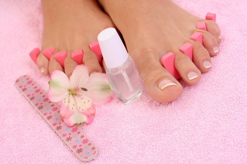 Pedicure. Beautiful female legs with perfect pedicure royalty free stock image