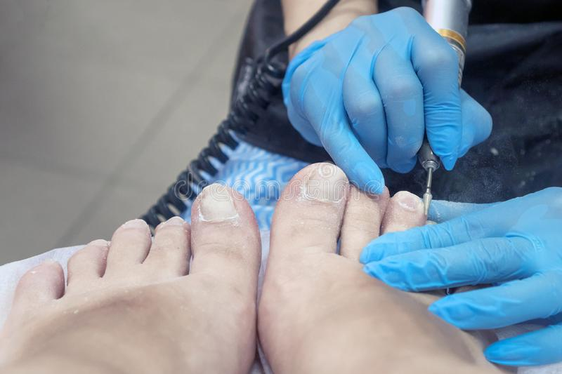 Pedicure makes the apparatus royalty free stock photos
