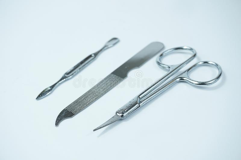 Pedicure Set scissors and nail file isolated on white background royalty free stock photography