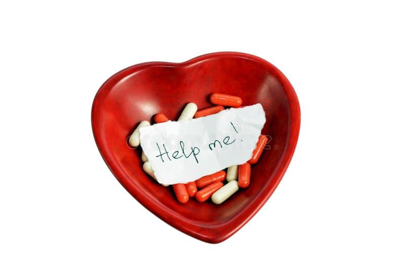Pedido la ayuda en el corazón rojo fotos de archivo