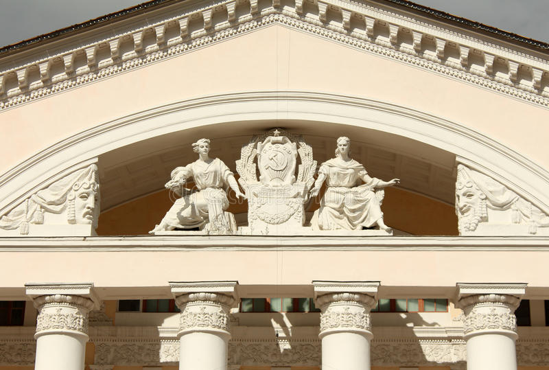 Pediment of Kaluga Drama Theatre. Sculptural group on the pediment of the Kaluga Drama Theatre stock photo