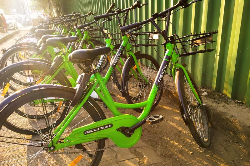 pedl by zoomcar rental cycles on the streets of Pune, India in october 2018 royalty free stock photo