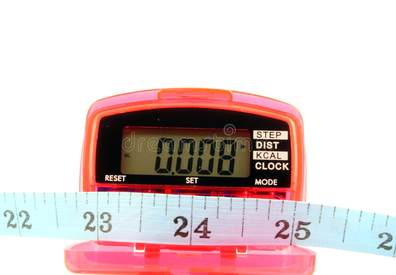 Pedometer with tape measure. Close up of a Pedometer and tape measure - isolated on a white background royalty free stock image