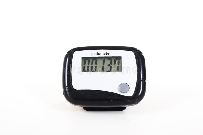 Pedometer for walking exercise. Step counter. White isolated background. royalty free stock photography